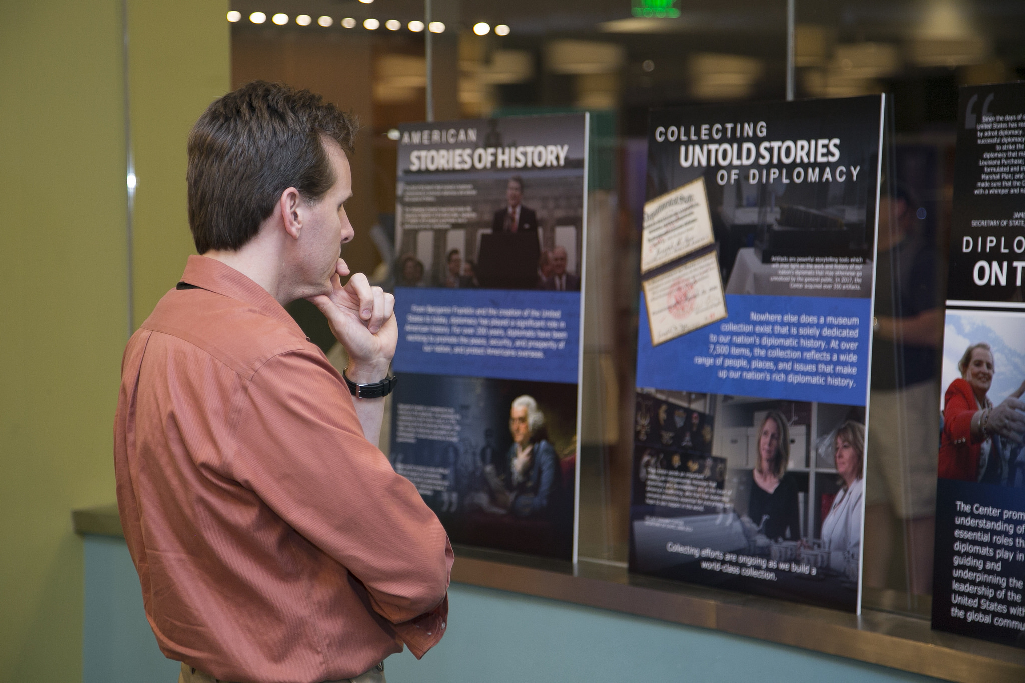 A man observes the posters of the Diplomacy Center