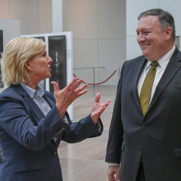 Director Mary Kane speaks to Mike Pompeo