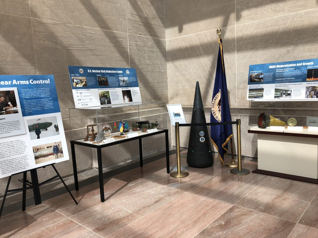 Diplomacy Center exhibit cases of Nuclear Arms including flags, artifacts, and information