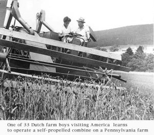 A young Dutch farm boy learns to operate a combine while visiting the U.S.