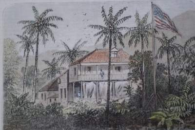 An image shows the U.S. compound in Haiti where Bassett and his family lived