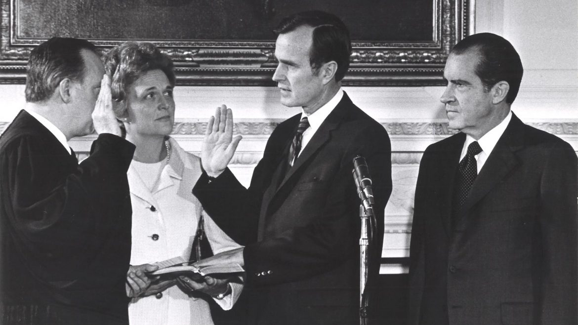 A young H.W. Bush with Nixon at his side swears over the Bible