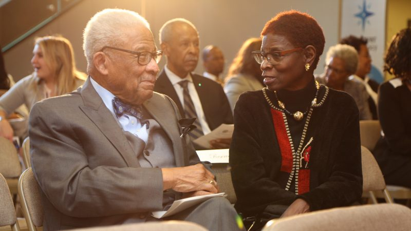 Ambassador Horace Dawson speaks to attendee, a retired Foreign Service Officer.