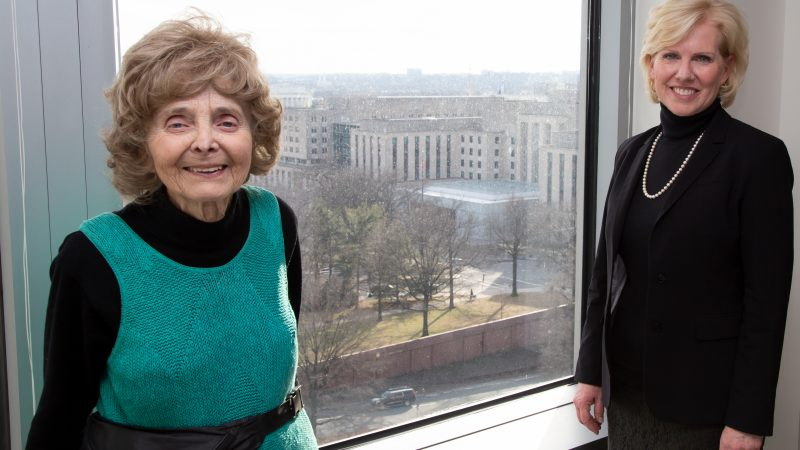 Patti Morton stands smiling next to Diplomacy Center Mary Kane