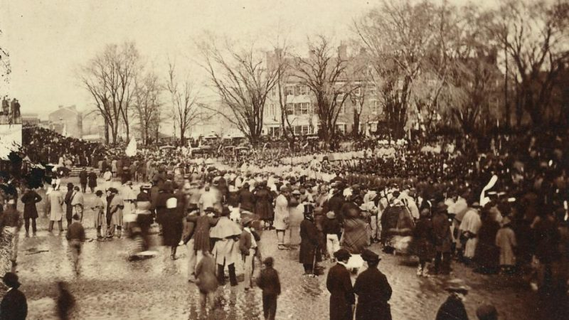 Old photograph of Washington DC bridge and crowd