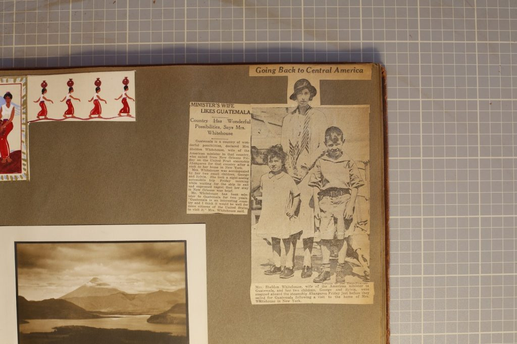 Scrapbook with photos and drawing of person