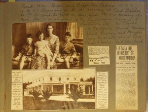 Page of old scrapbook featuring family of four