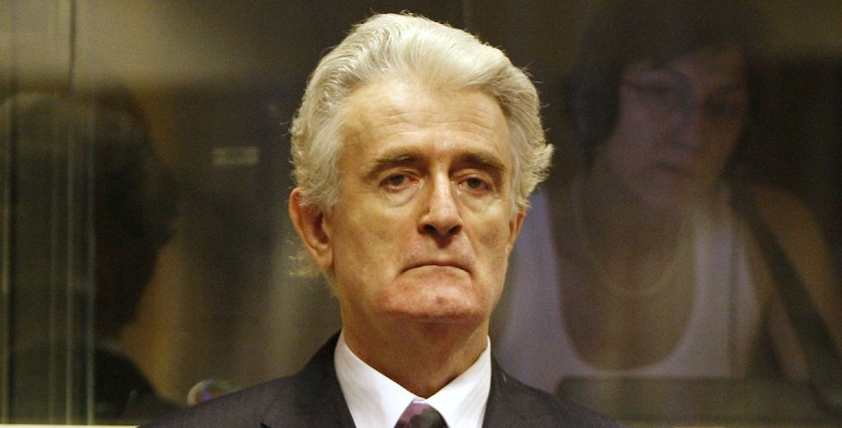 Former Bosnian Serb leader Radovan Karadzic stands in the courtroom during his initial appearance at the UN's Yugoslav war crimes tribunal in The Hague, Netherlands.