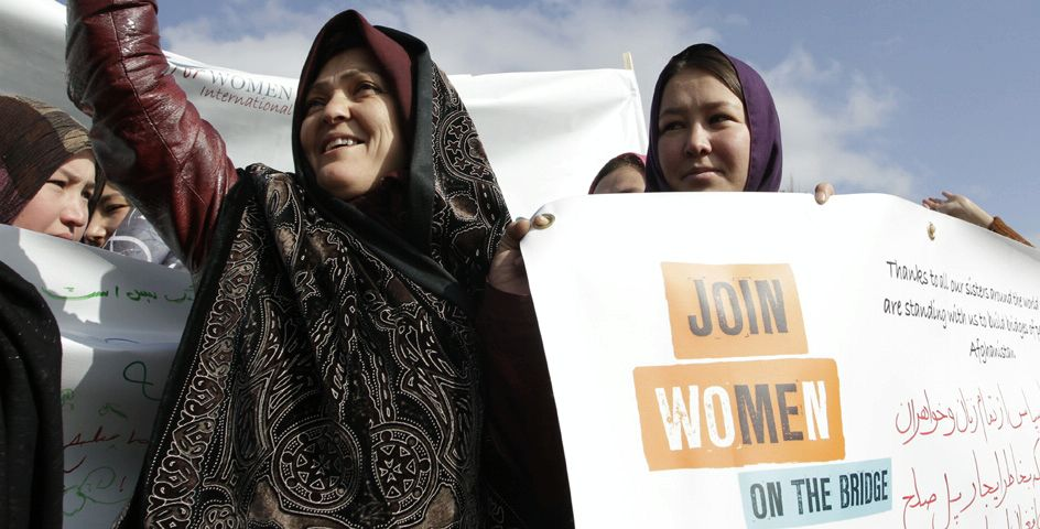 An Afghan woman celebrates the upcoming International Women's Day with Women for Women International in Kabul, Afghanistan.