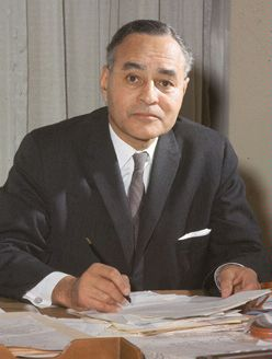 portrait of Ralph Bunche at his work desk