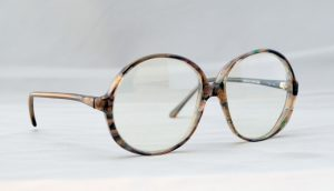 old spectacles on minimalistic background