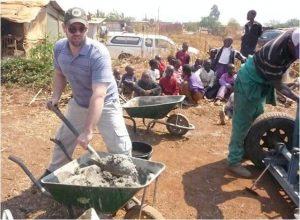 Embassy staff members help make bricks for a cooperative group in Hatcliffe Extension in Harare.