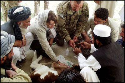 U.S. bio-engagement program officer training Pakistani health care specialists new animal vaccination techniques.
