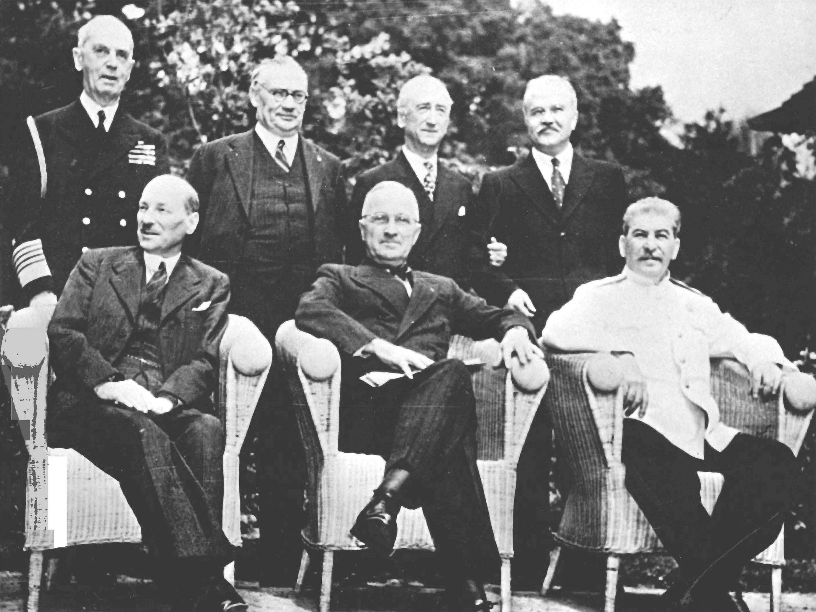 Seated are (left to right): British Prime Minister Clement Atlee; U.S. President Harry Truman; and Soviet Premier Joseph Stalin. Standing behind them are (left ot right): Fleet Admiral William D. Leahy, USN, Truman's Chief of Staff; British Foreign Minister Ernest Bevin; U.S. Secretary of State James F. Byrnes and Soviet Foreign Minister Vyacheslav Molotov.