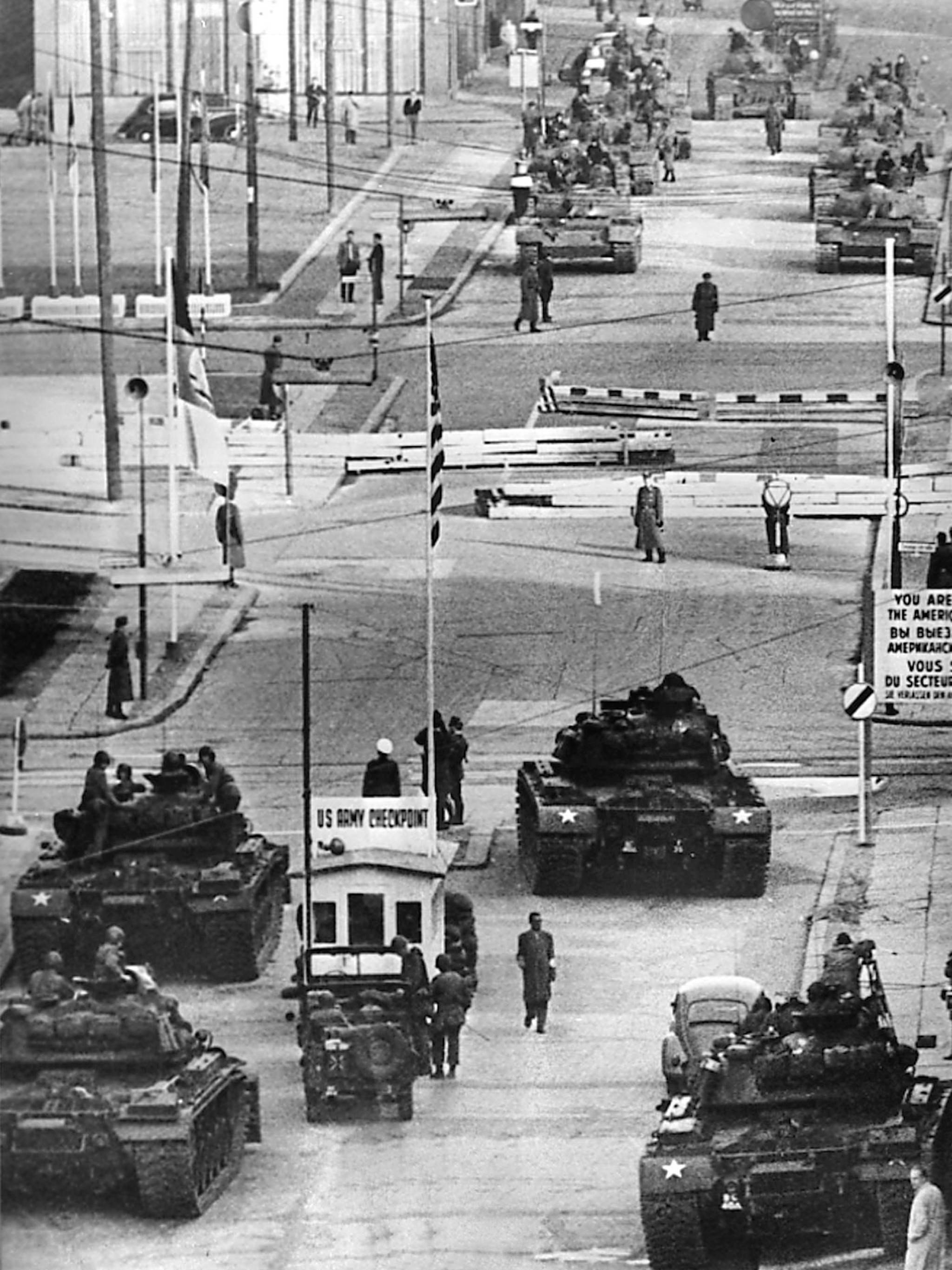 U.S. Army tanks, foreground, face off against Soviet tanks across the Berlin Wall at Checkpoint Charlie on the Friedrichstrasse, in a tense standoff on Oct. 27 and 28, 1961.