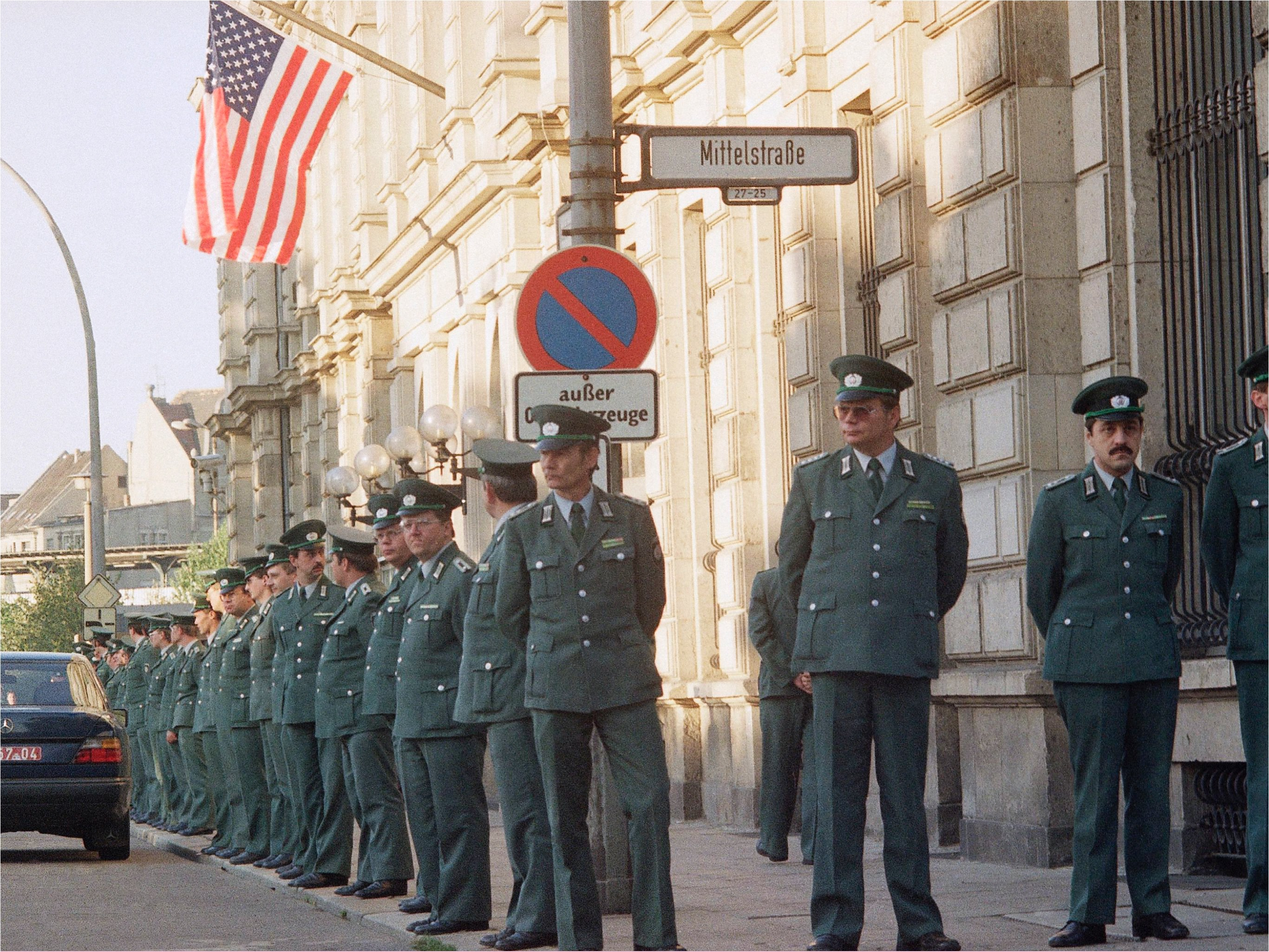 German police guard the U.S. Embassy to East Berlin