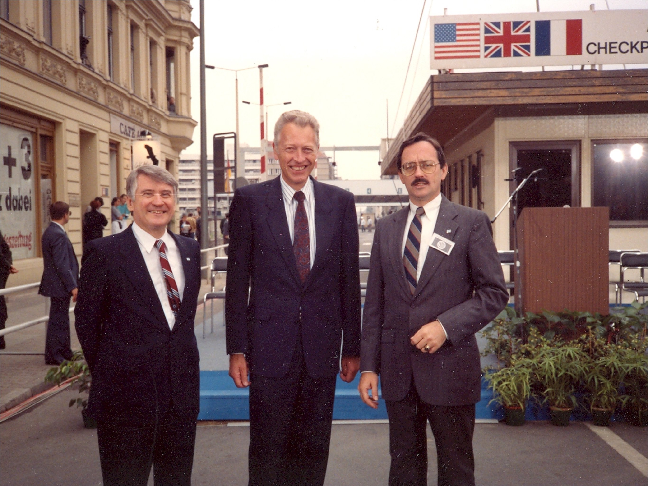 U.S. Minister to West Berlin Harry Gilmore (left); U.S. Minister to East Berlin, J.D. Bindenagel (right), and West German Political Director Dieter Kastrup (center) attending the Decommissioning of Checkpoint Charlie, Berlin.
