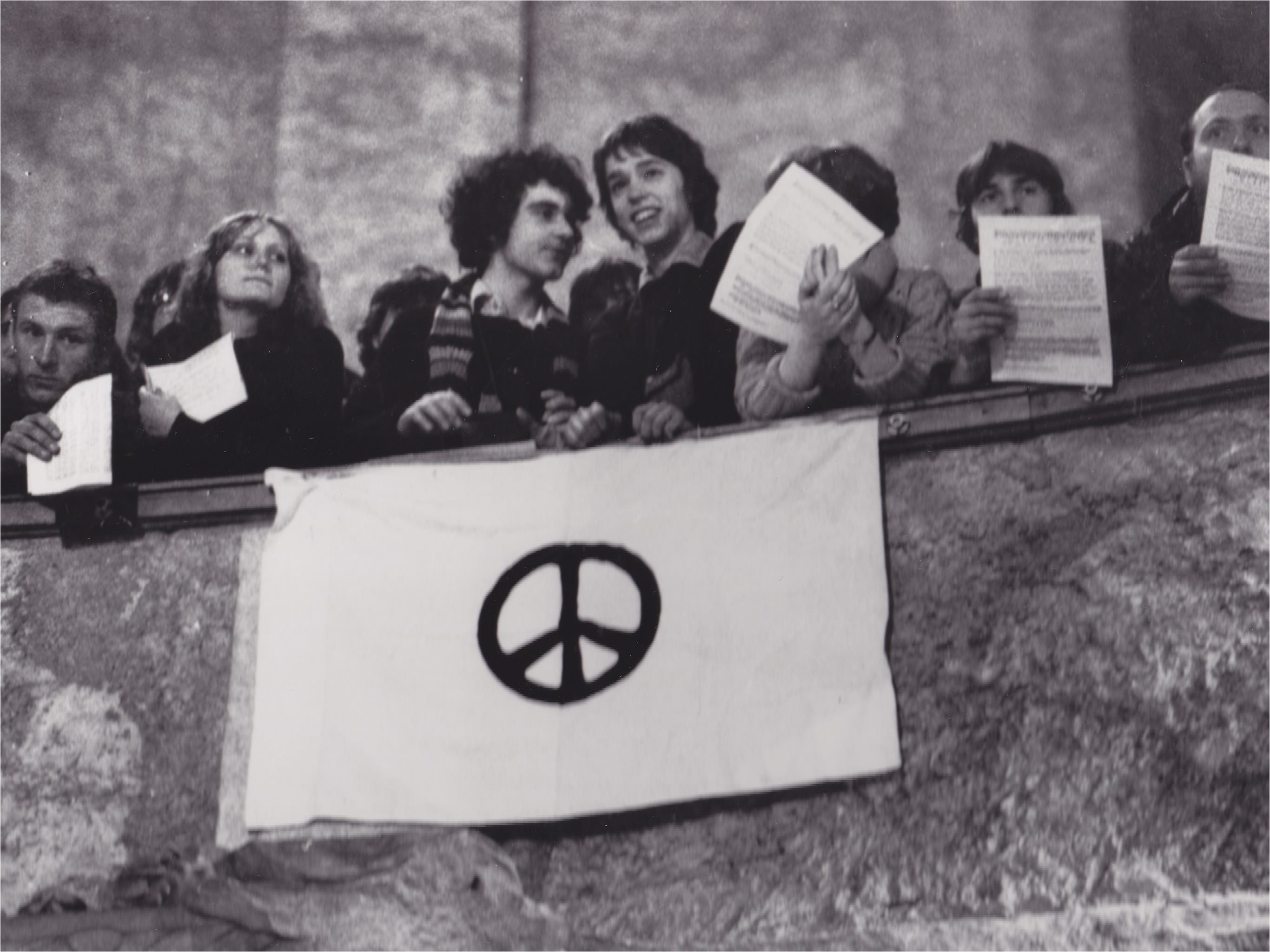 Students appear here at a 1982 Peace Forum in Dresden, East Germany, displaying a universally recognized sign for peace