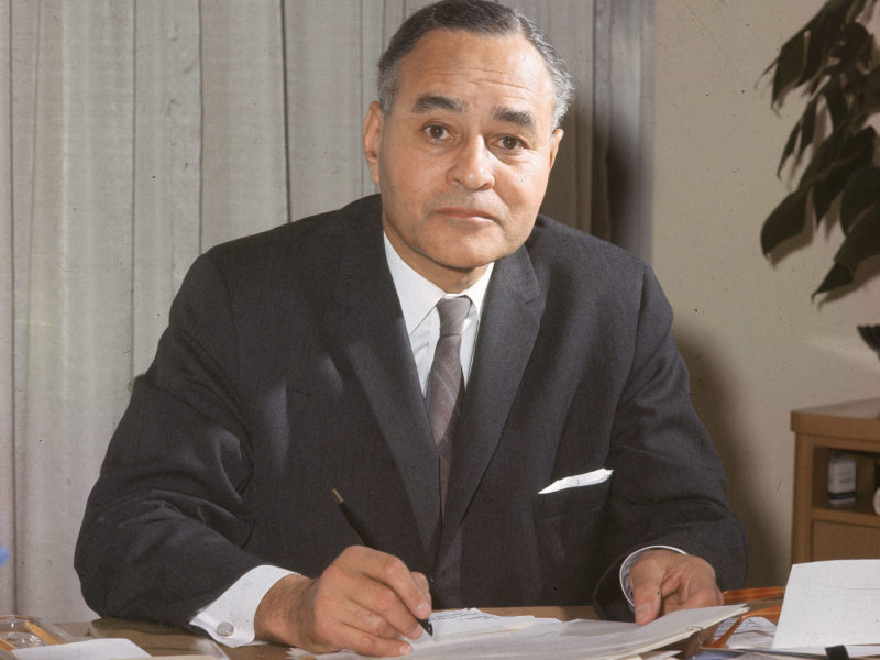 Ralph Bunche, United Nations Undersecretary General, signs papers at his desk in his office at the U.N. headquarters in New York City, April 26, 1963.