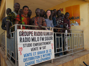 Public Affairs Officer Emily Green, pictured with the staff of a local radio station in Guinea in 2014.