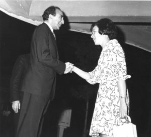 Lois Roth welcomes the Minister of the Imperial Court at the entrance of the IAS cultural center. Photo courtesy of Dick Arndt.