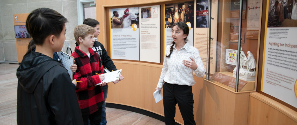 students discuss the exhibit together