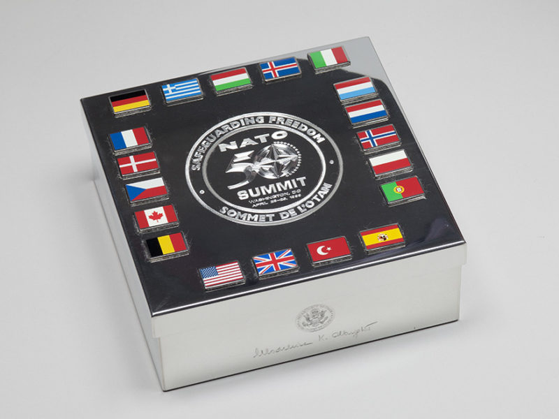 """In April 1999, NATO leaders gathered in Washington, D.C. to commemorate the alliance's 50th anniversary. A key theme of the conference was """"Safeguarding Freedom"""" as inscribed on this silver lidded box. Secretary Albright gave this gift to her NATO allies at the conference. Collection of the National Museum of American Diplomacy."""