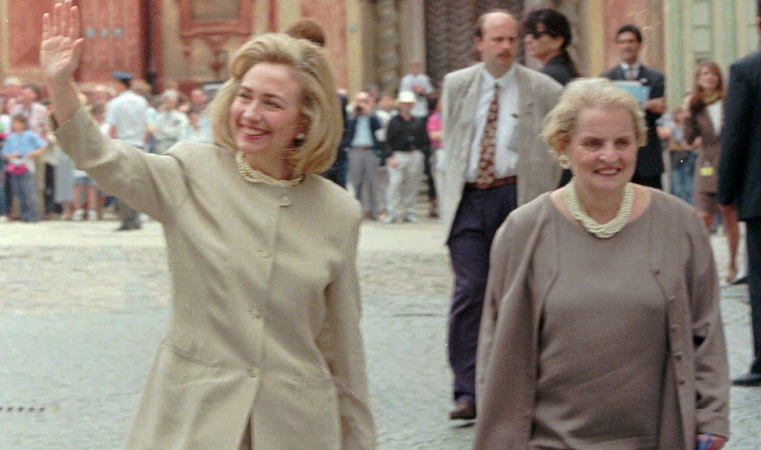 Cropped: First lady Hillary Rodham Clinton, left, is accompanied by Madeleine Albright, U.S Ambassador to the United Nations, right, and waves to Prague citizens on her tour at the Castle of Prague Friday July 5, 1996. Mrs Clinton leaves the Czech Republic Saturday for Slovakia and Hungary