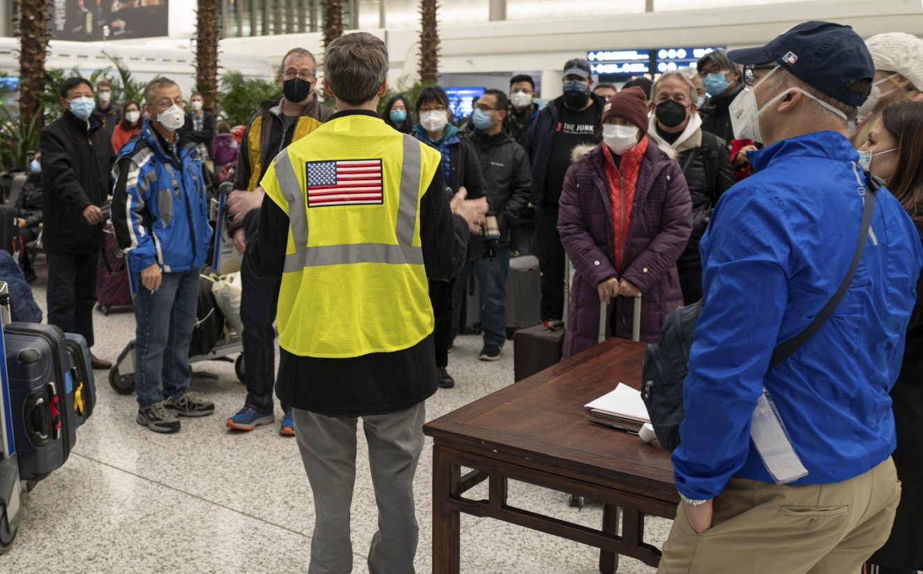 Consul General Wuhan staff explain luggage handling procedures to U.S. citizen evacuees at the Wuhan International Airport, January 28, 2020