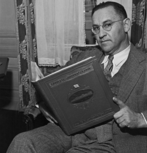 """Meyer Franklin Kline, pictured in September 1935 holding a copy of the guidebook that he had spent over 20 years compiling and editing."