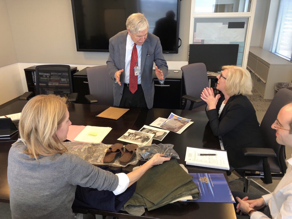 Limbert discusses his clothing donation with NMAD staff